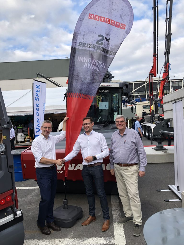 Bob Kegelars shaking hand with Van Der Spek representatives at MATEXPO